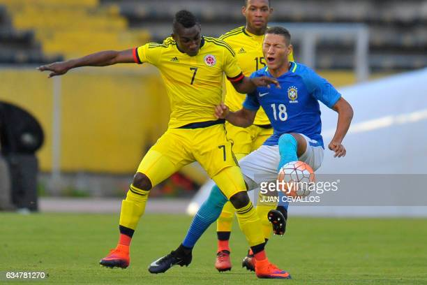 Brazil`s player Richarlison vies for the ball with Colombia`s Julian Andres Quinones during their South American Championship Sub20 football match at...