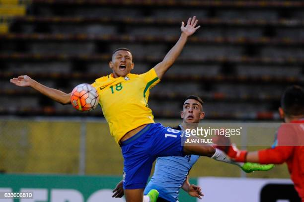 Brazil's player Richarlison vies for the ball with Uruguay's player Jose Rodriguez during their South American Championship U20 football match in the...