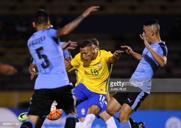 Brazil's player Richarlison vies for the ball with Uruguay's players during their South American Championship U20 football match in the Olimpico...