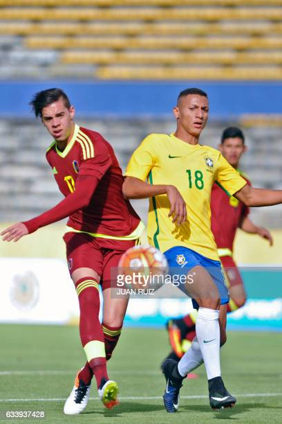 Brazil's player Richarlison vies for the ball with Venezuela's player Josue Mejias during their South American Championship U20 football match at the...