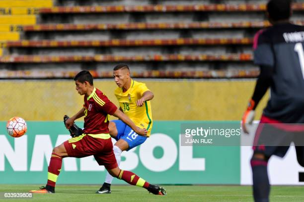 Brazil's player Richarlison vies for the ball with Venezuela's player Ronald Hernandez during their South American Championship U20 football match at...