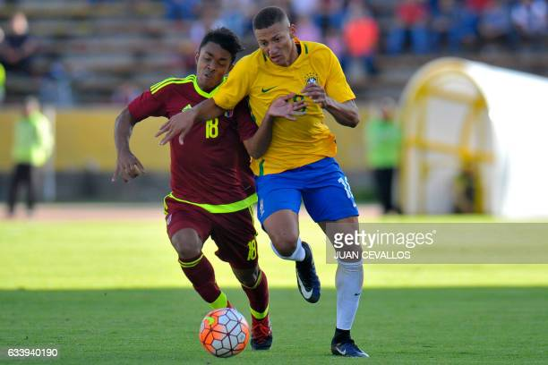 Brazil's player Richarlison vies for the ball with Venezuela's player Luis Ruiz during their South American Championship U20 football match at the...