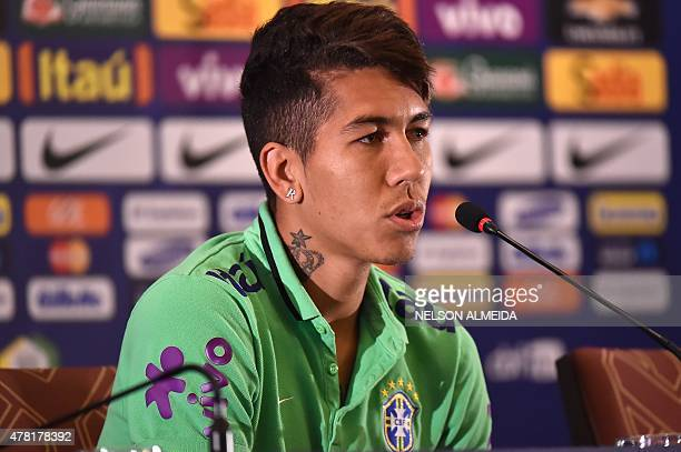 Brazil's player Roberto Firmino speaks during a press conference in Santiago Chile on June 23 2015 during the Copa America 2015 AFP PHOTO / Nelson...