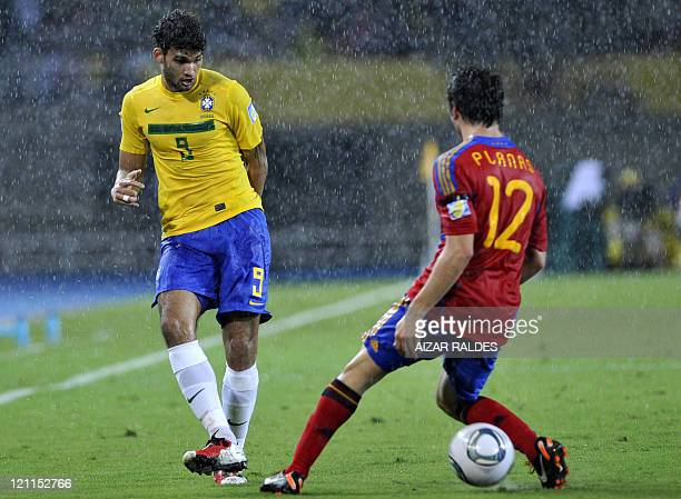 Brazil's player Willan Da Silva vies for the ball with Carles Planas from Spain during their FIFA U20 World Cup football match at the Hernan Ramirez...