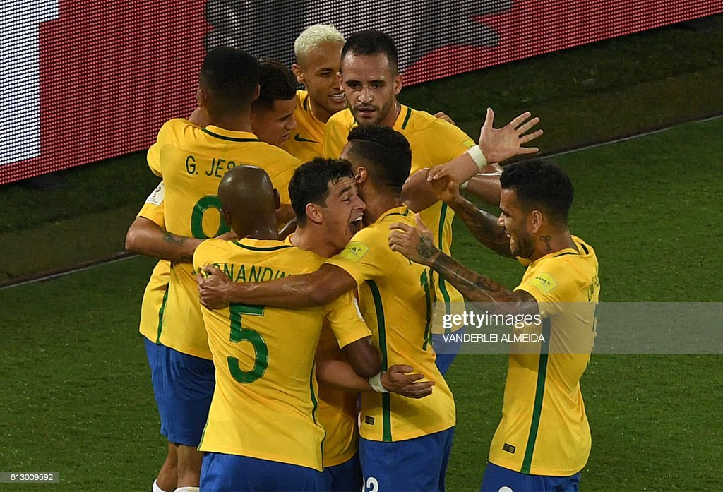 Brazil's players celebrate a goal against Bolivia during their Russia 2018 World Cup qualifier football match in Natal, Brazil, on October 6, 2016. / AFP / VANDERLEI