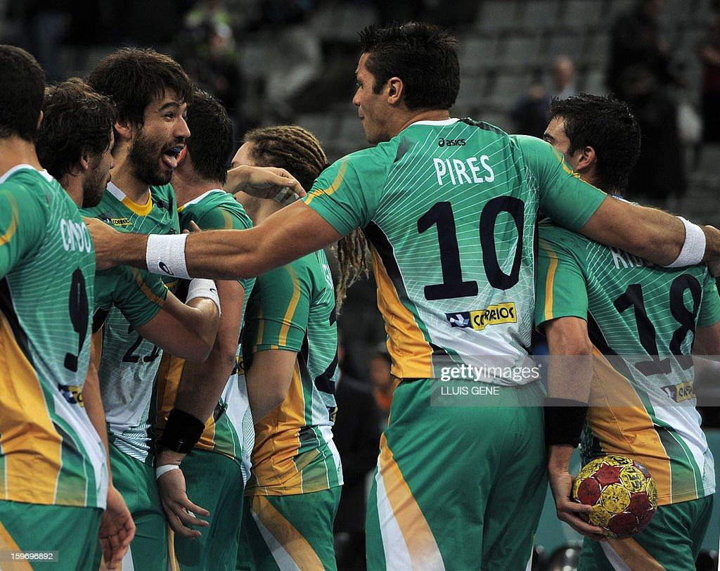 Brazil's players celebrate after winning the 23rd Men's Handball World Championships preliminary round Group A match Montenegro vs Brazil at the Palau Sant Jordi in Barcelona on January 18, 2013. Brazil won after won 26-25.