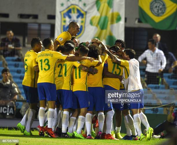 Brazil's players celebrate during their 2018 FIFA World Cup qualifier football match against Uruguay at the Centenario stadium in Montevideo on March...