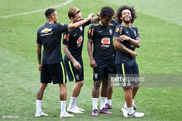 Brazil's players Neymar Philippe Coutinho Willian and Marcelo joke during a training session at Mineirao stadium in Belo Horizonte Minas Gerais...