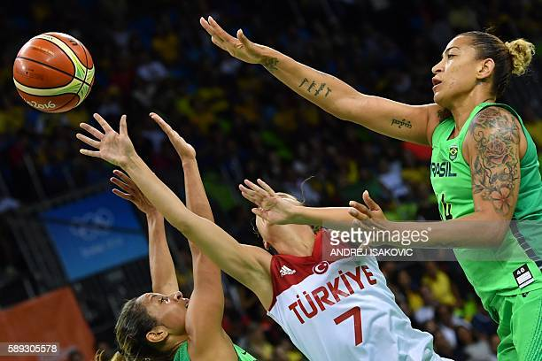 TOPSHOT Brazil's point guard Adriana Moises Turkey's point guard Birsel Vardarli Demirmen and Brazil's centre Erika Souza go for a rebound during a...