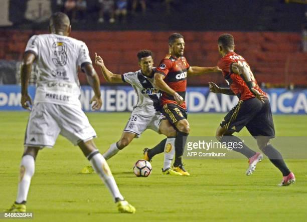 Brazil's Ponte Preta player Naldo struggles for the ball with Brazil's Sport Recife footballer Diego Souza during the Copa Sudamericana football...