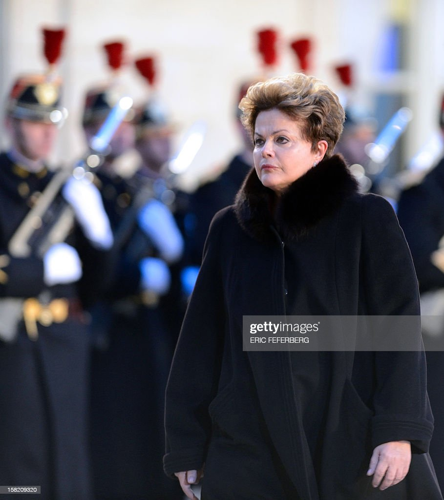 Brazil's president Dilma Rousseff arrives on December 11, 2012 at the Elysee presidential palace in Paris, prior to a meeting with her French counterpart. Brazilian President Dilma Rousseff kicks off her first official visit to France, where a decision on whether she will choose Rafale fighter jets or opt for another aircraft is keenly awaited. During the two-day trip Rousseff will have talks with French counterpart Francois Hollande on the eurozone crisis -- on which she has criticized EU austerity measures -- bilateral trade and wider matters of global concern.