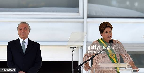 Brazil's President Dilma Rousseff delivers a speech next to her VicePresident Michel Temer during her second term inauguration in Brasilia on January...
