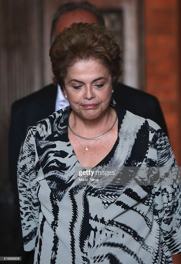 Brazil's President <a gi-track='captionPersonalityLinkClicked' href=/galleries/search?phrase=Dilma+Rousseff&family=editorial&specificpeople=1955968 ng-click='$event.stopPropagation()'>Dilma Rousseff</a> walks in the Oswaldo Cruz Foundation on March 10, 2016 in Rio de Janeiro, Brazil. The prominent science and health institute is studying methods to combat the Aedes aegypti mosquito which transmits the Zika virus. Prosecutors have filed charges of money laundering against former President Luiz Inacio Lula da Silva in part of a massive corruption scandal. Protests calling for the impeachment of President Rousseff are scheduled for Sunday.