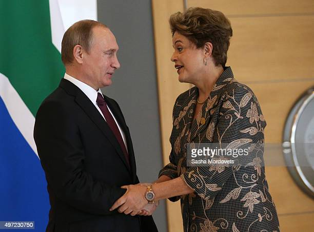 Brazil's President Dilmah Rousseff greets Russian President Vladimir Putin during the BRICS leaders meeting prior to G20 Antalya Summit in Belek near...