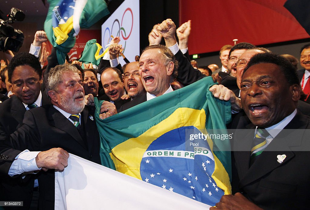 Brazil's President Luiz Inacio Lula da Silva left Rio 2016 bid President Carlos Arthur Nuzman center and Brazilian soccer great Pele right celebrate...