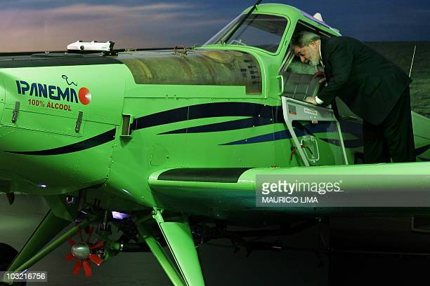 Brazil's President Luiz Inacio Lula da Silva looks inside the cockpit of a 100 percent ethanol powered aircraft made in Brazil by manufacturer jets...