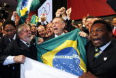 Brazil's President Luiz Inacio Lula da Silva Rio 2016 bid President Carlos Arthur Nuzman and Brazilian football legend Pele celebrate with their...