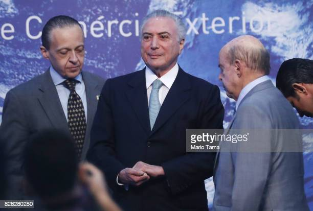 Brazil's President Michel Temer stands at the National Meeting for Foreign Trade on August 9 2017 in Rio de Janeiro Brazil The unpopular president...