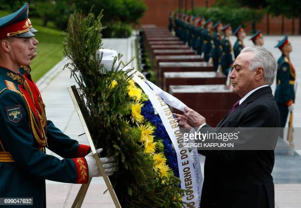 Brazil's President Michel Temer takes part in a wreathlaying ceremony at the Tomb of the Unknown Soldier by the Kremlin wall in Moscow on June 21...