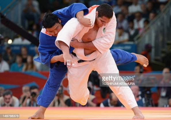 Brazil's Rafael Silva competes with Korea's Kim SungMin during their men's 100kg judo contest bronze medal match of the London 2012 Olympic Games on...