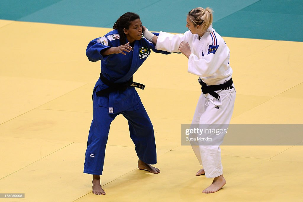 Brazil's <a gi-track='captionPersonalityLinkClicked' href=/galleries/search?phrase=Rafaela+Silva&family=editorial&specificpeople=7010365 ng-click='$event.stopPropagation()'>Rafaela Silva</a> (L) competes with France's <a gi-track='captionPersonalityLinkClicked' href=/galleries/search?phrase=Automne+Pavia&family=editorial&specificpeople=7182223 ng-click='$event.stopPropagation()'>Automne Pavia</a> during the semi-final in the Women's 57kg category of the IJF World Judo Championship at Gymnasium Maracanazinho on August 28, 2013 in Rio de Janeiro, Brazil.