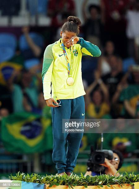 Brazil's Rafaela Silva is overcome with emotion on the podium after winning the women's 57kilogram judo gold at the Rio de Janeiro Olympics on Aug 8...