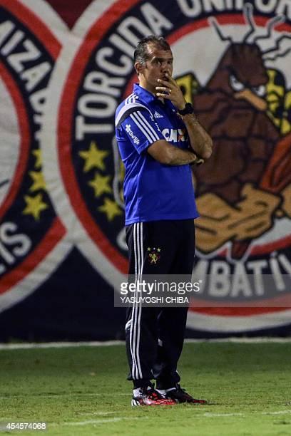 Brazils Recife's head coach Eduardo Baptista looks on during the Copa Sudamericana match against Brazils Vitoria at Manoel Barradas Stadium in...