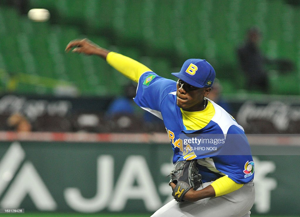 Brazil's relief pitcher Thyago Vieira throws the ball against China during the eighth inning of their first-round Pool A game in the World Baseball Classic tournament in Fukuoka on March 5, 2013. China beat Brazil 5-2. AFP PHOTO / KAZUHIRO NOGI