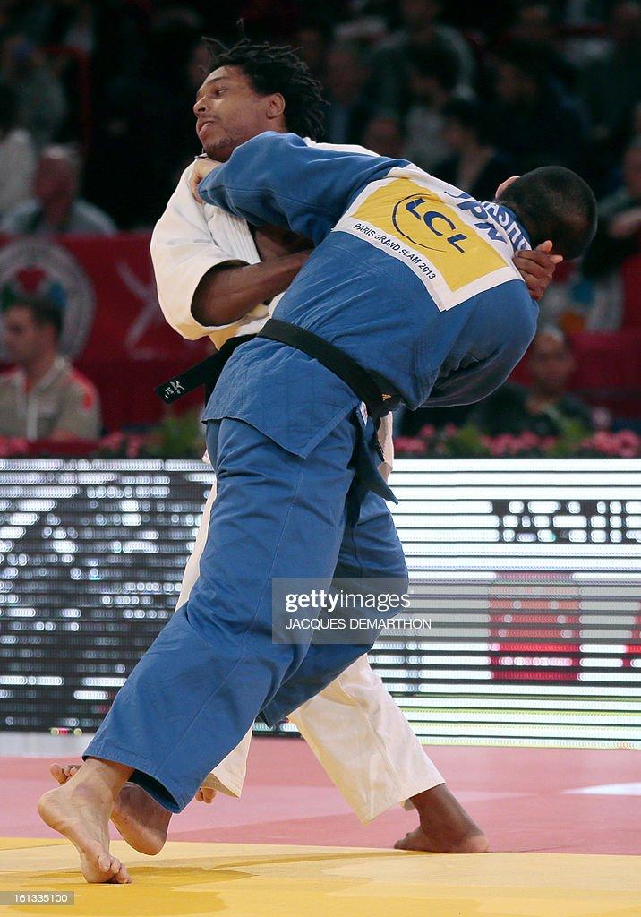 Brazil's Renan Nunes (white) fights against Japan's Kumashiro Yusuke (blue) on February 10, 2013 in Paris, during the eliminatories of the Men -100kg of the Paris Judo Grand Slam tournament.