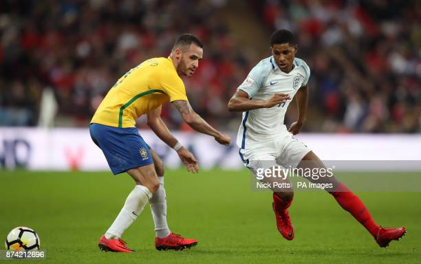 Brazil's Renato Augusto and England's Marcus Rashford in action during the Bobby Moore Fund International match at Wembley Stadium London