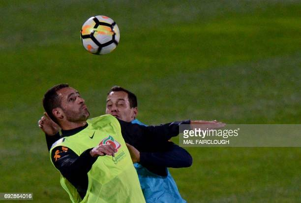 Brazil's Renato Augusto and Rodriguinho Marinho participate in a football training session in Melbourne on June 6 ahead of their match against...