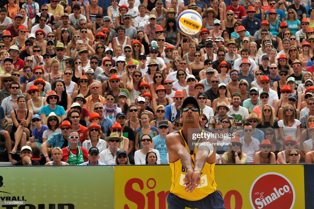 Brazil's Ricardo Santos sets during the Ricardo-Alvaro Filho v Brouwer-Meeuwsen semi-finals match as part of the FIVB Gstaad Grand Slam fifth day on July 13, 2013 in Gstaad, Switzerland.