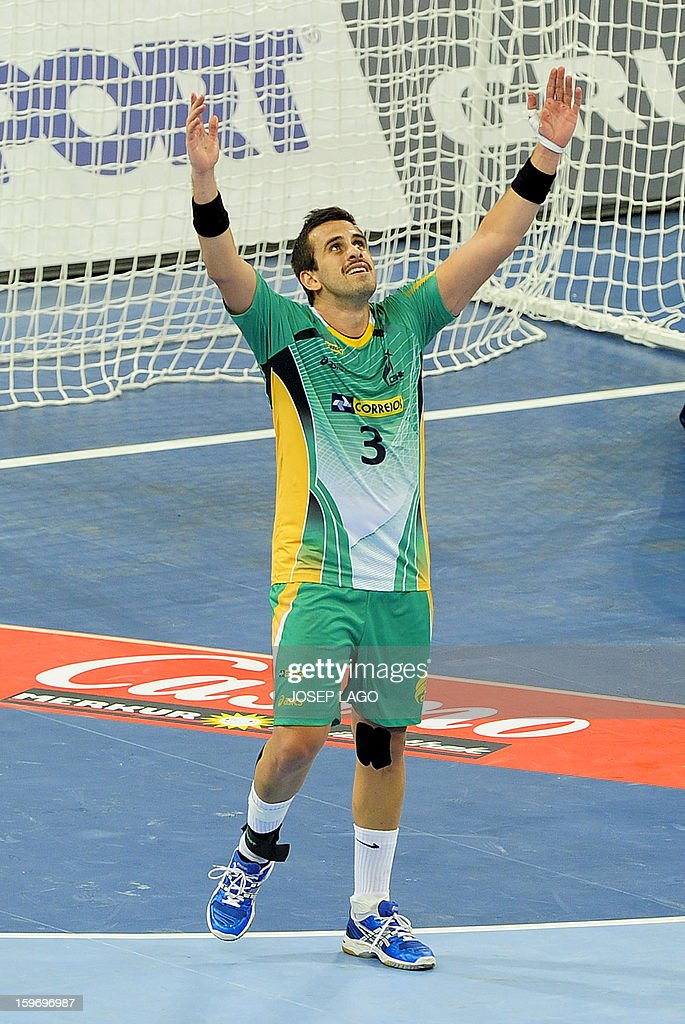 Brazil's right back Fernando Jose Pacheco celebrates after winning the 23rd Men's Handball World Championships preliminary round Group A match Montenegro vs Brazil at the Palau Sant Jordi in Barcelona on January 18, 2013. Brazil won 26-25.