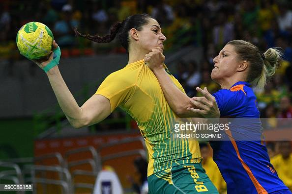 TOPSHOT Brazil's right wing Eduarda Amorim vies with Netherlands' centre back Nycke Groot during the women's quarterfinal handball match Brazil vs...