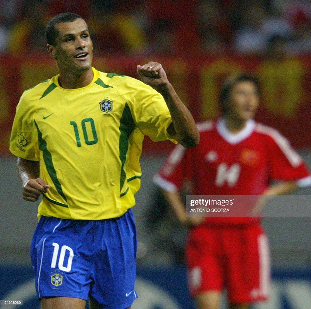 Brazil s Rivaldo L celebrates after scoring in t