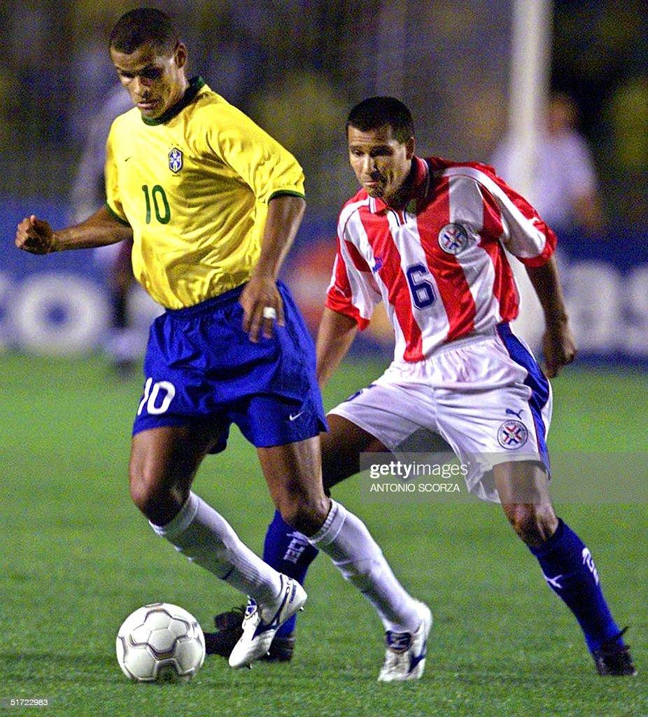 Brazil s Rivaldo 10 takes the ball past Paraguay