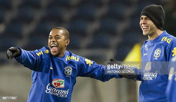 Brazil's Robinho and Kaka laugh during a traning session at Orlando Stadium on June 27 2009 in Soweto Johannesburg Brazil faces the USA national...