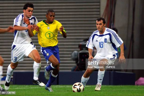 Brazil's Robinho finds himself surrounded by Greece's Pantelis Kafes Loukas Vyntra and Ioannis Goumas