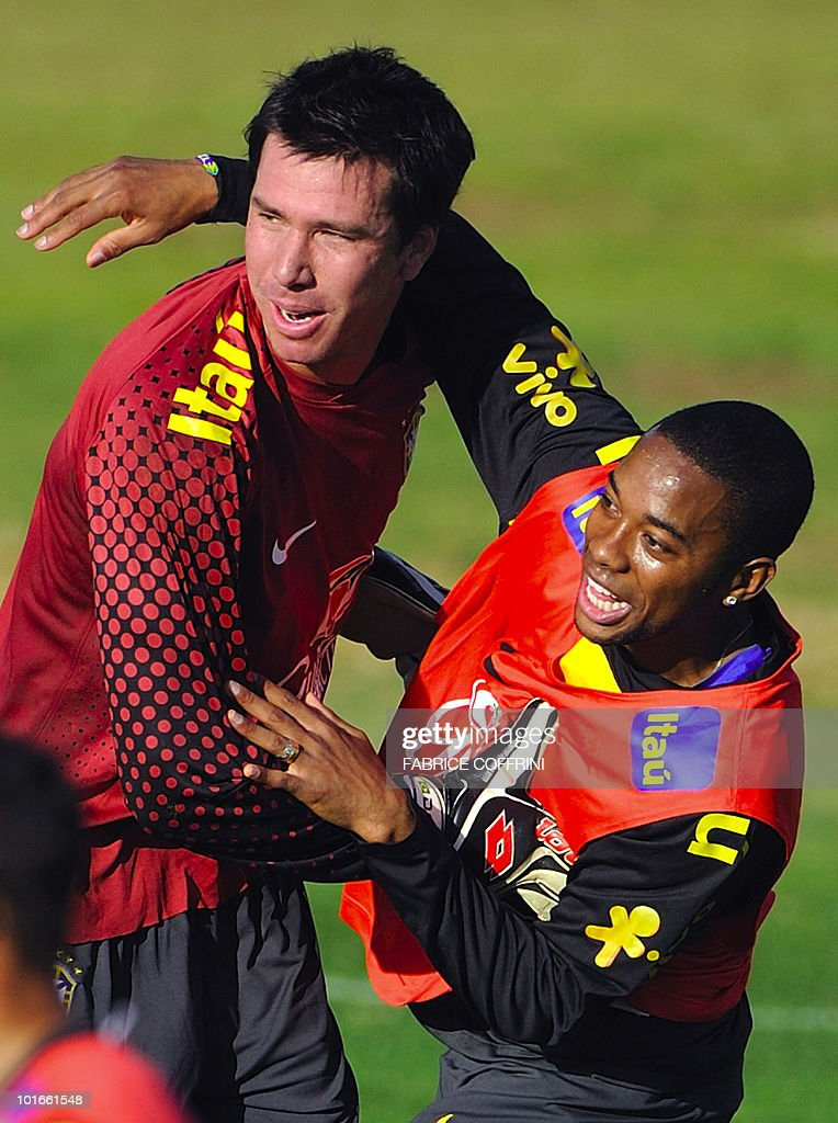 Brazil's Robinho (R) hugs second goalkeeper Doni during a training session at the Randburg High School on June 6, 2010 in Johannesburg ahead of the kick off of the South Africa 2010 World Cup. The 2010 World Cup will take place in South Africa from June 11 to July 11, the first time on African soil for the biggest and most prestigious competition in sport.
