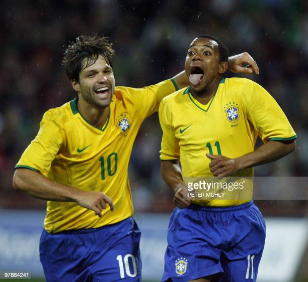 Brazil's Robson Souza celebrates with team mate Diego Ribas after scoreing a goal against Ireland on February 6 2008 during an International match in...