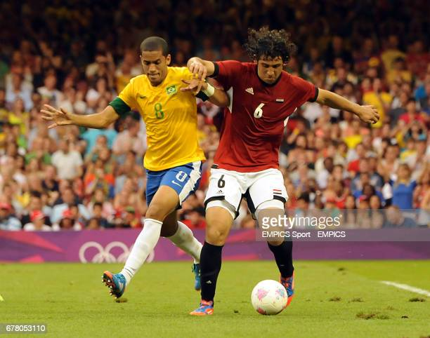 Brazil's Romulo and Egypt's Ahmed Hegazi battle for the ball during the Brazil v Egypt Mens Football First Round Group C match at the Millennium...