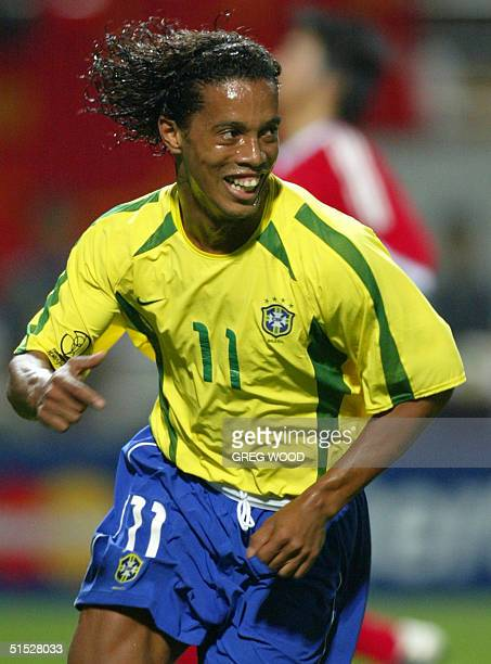 Brazil's Ronaldinho celebrates after scoring off a 43rd minute penalty 08 June 2002 at the Jeju World Cup Stadium in Seogwipo during first round...