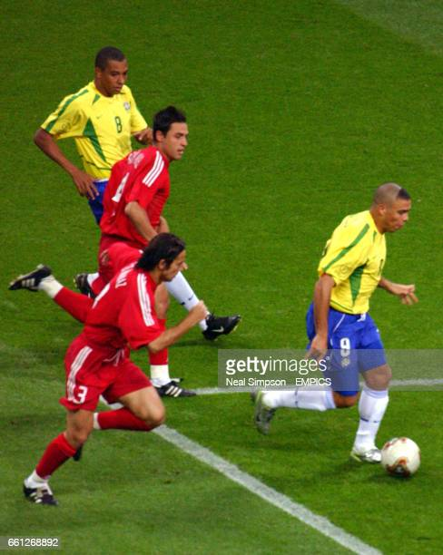 Brazil's Ronaldo bursts past Turkey's Bulent Recber and Fatih Akyel to score their winning goal