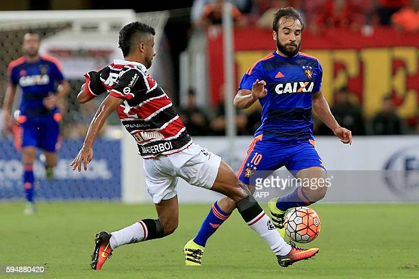 Brazil's Santa Cruz player Leo Mora vies for the ball with Brazils Sport Recife player Gabriel Xavier during the Copa Sudamericana match at Arena...