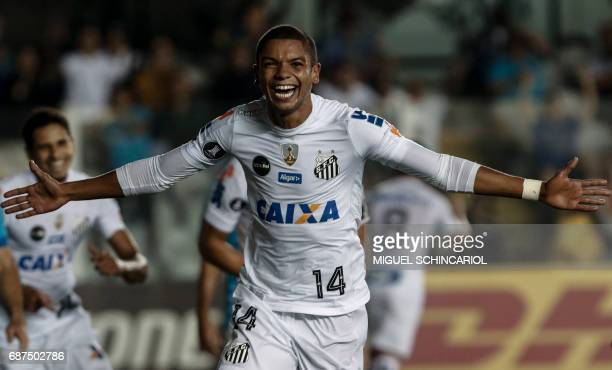Brazils Santos David Braz celebrates after scoring the team's fourth goal his second against Peru's Sporting Cristal during their Libertadores Cup...