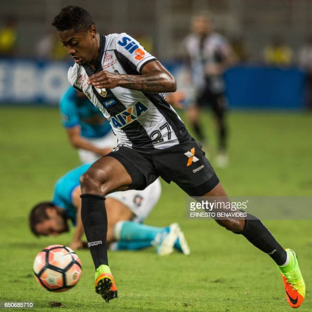 Brazil's Santos player Bruno Henrique vies for the ball with Peru's Sporting Cristal players during their Libertadores Cup football match at the...