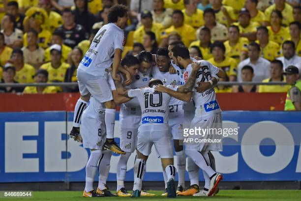 Brazil's Santos players celebrate after scoring a goal against Ecuador's Barcelona during their 2017 Copa Libertadores football match at the...