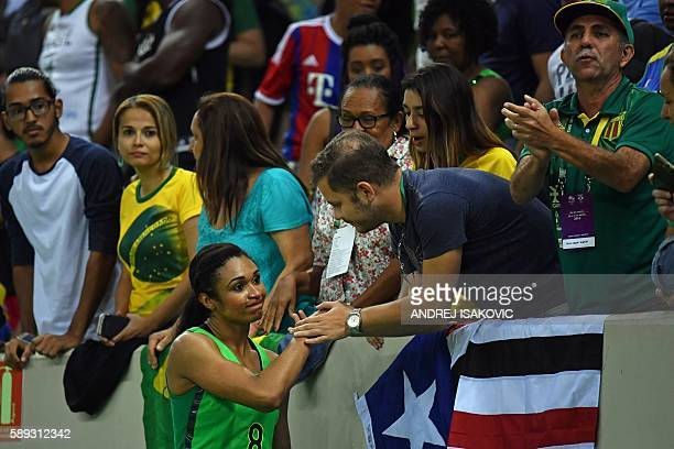 Brazil's shooting guard Iziane Castro is comforted by a fan after a Women's round Group A basketball match between Turkey and Brazil at the Youth...