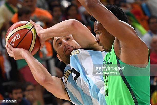 Brazil's shooting guard Leandro Barbosa defends against Argentina's shooting guard Manu Ginobili during a Men's round Group B basketball match...