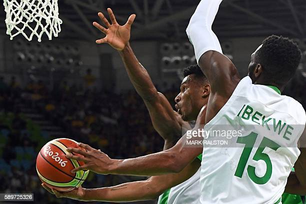 Brazil's shooting guard Leandro Barbosa goes to the basket under pressure from Nigeria's centre Ekene Ibekwe during a Men's round Group B basketball...